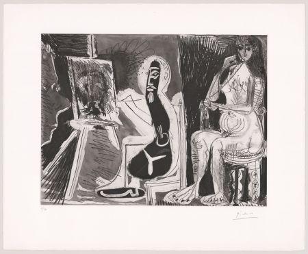 Radierung Und Aquatinta Picasso - Peintre avec le portrait d'un jeune garçon, dans son atelier.